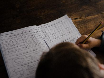 Photo (Boy Writing a Test) by Annie Spratt on Unsplash
